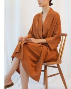 Girl sitting in Front Tie Midi Dress from a mente